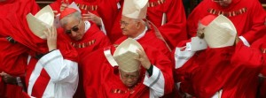 Cardinals' cassocks are blown by a gust of wind as they arrive for the funeral of Pope John Paul II at St. Peter's Basilica