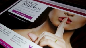 The homepage of the Ashley Madison website is displayed on an iPad, in this photo illustration taken in Ottawa, Canada July 21, 2015. Cheating spouses website AshleyMadison.com, facing hackers' threats to leak clients' nude photos and sexual fantasies, said it is heartened by some initial public response that sees the site as a victim. The website's Canadian parent, Avid Life Media, confirmed a breach of its systems that has put the real names, credit card information and other details of as many as 37 million customers at risk. Avid Life said it has since secured the sites and closed unauthorized access points.  REUTERS/Chris Wattie - RTX1L9GJ