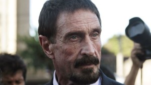 """John McAfee, U.S. anti-virus software guru, addresses a news conference outside the Supreme Court of Justice in Guatemala City December 4, 2012. McAfee, who is on the run from police in Belize seeking to question him in a murder probe, has crossed into Guatemala and said on Tuesday he will seek political asylum there. McAfee has been in hiding for three weeks since police in Belize said they wanted to question him as """"a person of interest"""" about the murder of fellow American Gregory Faull, with whom McAfee had quarrelled. REUTERS/William Gularte (GUATEMALA - Tags: CRIME LAW POLITICS HEADSHOT SCIENCE TECHNOLOGY) - RTR3B7S4"""